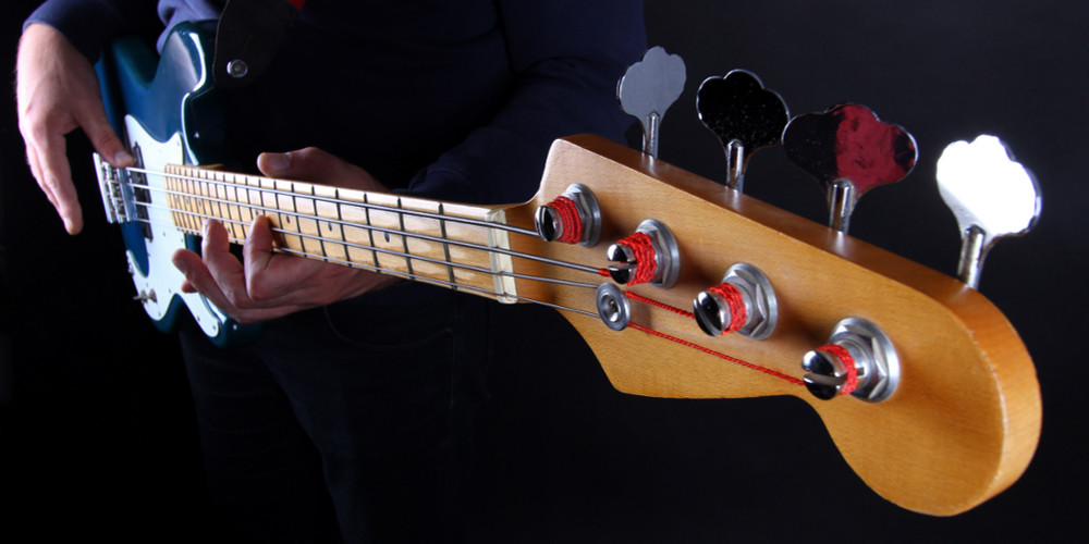 Featured image for home page of Knoxville Bass Lessons dotcom depicting male playing a classic electric bass guitar.